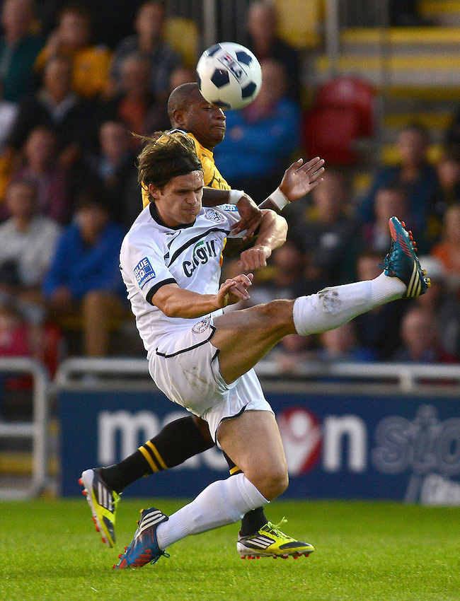 Hereford United's Andy Gallinagh battles with Newport County's Aaron O'Connor..Newport County V Hereford United - Blue square Premier division - Tuesday 28th August 2012 - Football  - Rodney Parade - Newport..
