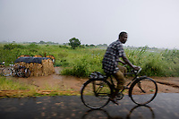 On his way home to the Caia resettlement camps. The camps are usually the first destination to those who have had to flee from the river. Later the government will give them land which is far from the risk areas. .The resettlement camps are filled with volunteers from the Red Cross who see to it that sanitation and water purification is up to standard.