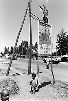 Ethiopia. Addis Ababa is the capital city and the name of a region of Ethiopia. On the road, a billboard indicates the place where is located the Circus Ethiopia. Circus Ethiopia was legally established in 1991 with a view to introduce circus art in Ethiopia. Ever since its creation Circus Ethiopia has given new dimension to  circus art in Ethiopia but as well internationally. By blending the art with the Ethiopian traditional costume, music and dance, Circus Ethiopia with its associative approach has inspired many circuses to grow throughout Ethiopia. © 1996  Didier Ruef