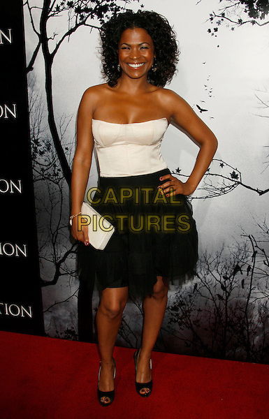 """NIA LONG.""""Premonition"""" World Premiere held at the ArcLight Cinerama Dome Theatre, Hollywood, California, USA..March 12th, 2007.full length black skirt white top strapless clutch purse hand on hip .CAP/ADM/RE.©Russ Elliot/AdMedia/Capital Pictures"""