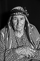 """Safi Haso, about 70 years old, from Girik village of Kobani. """"We are probably the last generation that has tattoos,"""" she says. """"All Kurdish women had them."""" In addition to facial, hand and neck tattoos, Haso has tattooed her own breast with circles around the nipples."""