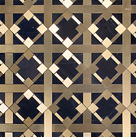 Kubuni, a waterjet stone mosaic, shown in honed Nero Marquina and brass. Designed by Joni Vanderslice as part of the J. Banks  Collection for New Ravenna.