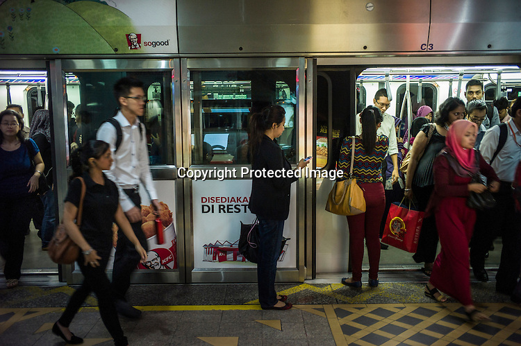 Commuters use the monorail metro service at KLCC in Kuala Lumpur, Malaysia. Photo: Sanjit Das/Panos