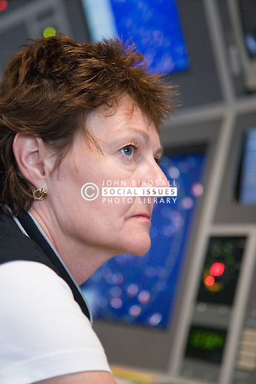 Air Traffic Control Tower Operator watching radar screens at East Midlands Airport,