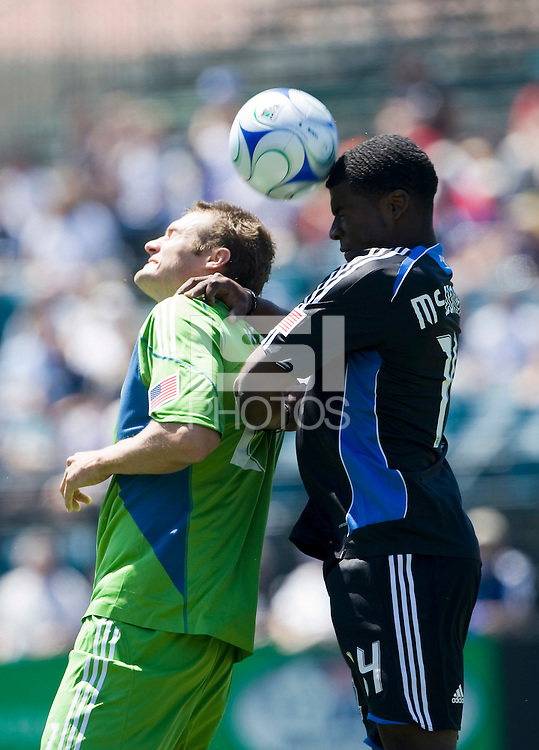 August 2nd, 2009: San Jose Earthquakes Brandon McDonald heads the ball behind Seattle Sounders Nate Jaqua during an MLS match at Buck Shaw Stadium in Santa Clara, California. San Jose Earthquakes defeated Seattle Sounders 4 - 0