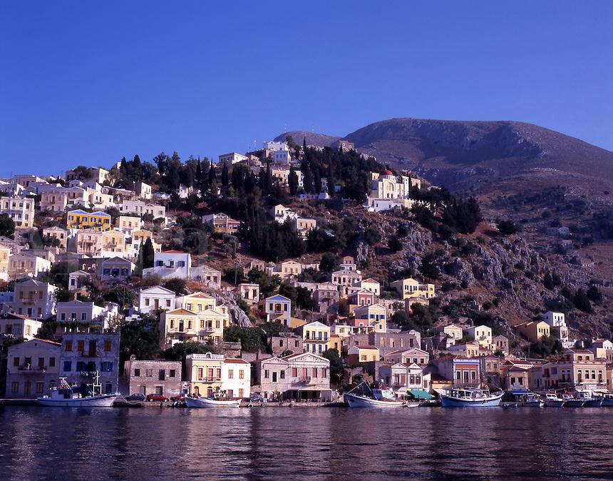 Greece. Dodecanese Islands. Symi. Neo classical houses. Symi town harbor. Gialos.