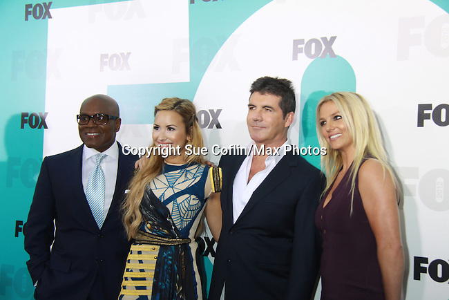 The X-Factor judges L.A. Reid, Demi Lavato, Simon Cowell, Brittany Spears at The Fox 2012 Programming Presentation on May 14, 2012 at Wollman Rink, Central Park, New York City, New York. (Photo by Sue Coflin/Max Photos) 917-647-8403