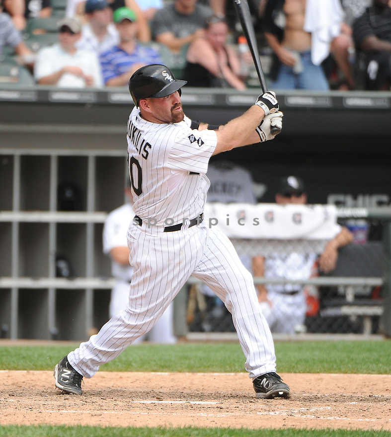 KEVIN YOUKILIS (20) of the Chicago White Sox in action during the White Sox game against the Texas Rangers on July 5, 2012 at US Cellular Field in Chicago, IL. The White Sox beat the Rangers 2-1.
