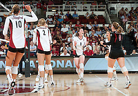 STANFORD, CA - September 2, 2010: Cassidy Lichtman (8) celebrates with her team during a volleyball match against UC Irvine in Stanford, California. Stanford won 3-0.