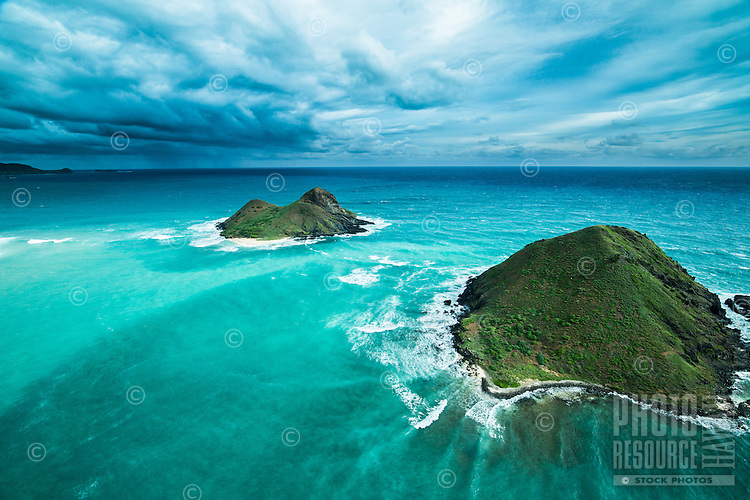 An aerial view of Na Mokulua (Mokulua islets) near Lanikai, a neighborhood along the Windward coast of O'ahu.