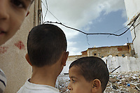 Children playing in the street of Tunis the day before the country was to vote in the first democraticaly held elections
