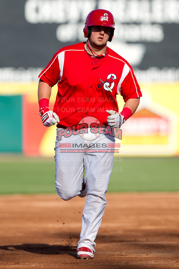 Matthew Adams (25) of the Springfield Cardinals rounds the bases after hitting a home run during a game against the Frisco RoughRiders on April 16, 2011 at Hammons Field in Springfield, Missouri.  Photo By David Welker/Four Seam Images