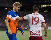 Cincinnati, OH - Tuesday August 15, 2017: Kevin Schindler, Alex Muyl during a 2017 U.S. Open Cup game between FC Cincinnati vs New York Red Bulls at Nippert Stadium.