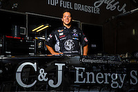 Sept. 1, 2014; Clermont, IN, USA; NHRA top fuel dragster driver Dave Connolly poses for a portrait in the pits during the US Nationals at Lucas Oil Raceway. Mandatory Credit: Mark J. Rebilas-USA TODAY Sports