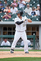 George Kottaras (20) of the Charlotte Knights at bat against the Norfolk Tides at BB&T BallPark on June 7, 2015 in Charlotte, North Carolina.  The Tides defeated the Knights 4-1.  (Brian Westerholt/Four Seam Images)
