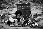 "Potosi, Bolivia. The family of a miner waiting on the road to the ""Cerro Rico""."
