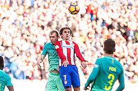 Jeremy Mathieu of Futbol Club Barcelona competes for the ball with Antoine Griezmann of Atletico de Madrid  during the match of Spanish La Liga between Atletico de Madrid and Futbol Club Barcelona at Vicente Calderon Stadium in Madrid, Spain. February 26, 2017. (ALTERPHOTOS) /NortEPhoto.com