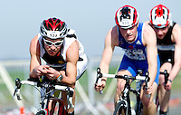 25 MAR 2012 - LOUGHBOROUGH, GBR - Robbie Whitaker leads a pack on the bike during the 2012 British Elite Men's Duathlon Championship race at Prestwold Hall Airfield in Prestwold near Loughborough, Great Britain (PHOTO (C) 2012 NIGEL FARROW)