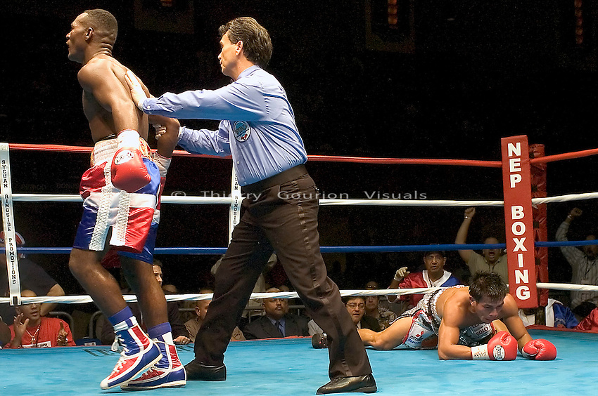 Joan Guzman is sent to the neutral corner after knocking Terdsak Jandaeng (r) down during their WBO Featherweight Eliminator Fight at the Westchester County Center, White Plains, NY on 08.26.2005..Guzman won by unanimous decision.