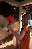 Temple School Novice Monks at Wat Siphoutthabat - Most male Lao youths spend time in a temple or monastery, before becoming adults.   The Buddhism practiced in Laos is of the Theravada tradition,  a  version of Theravada Buddhism and the basis of Lao culture.