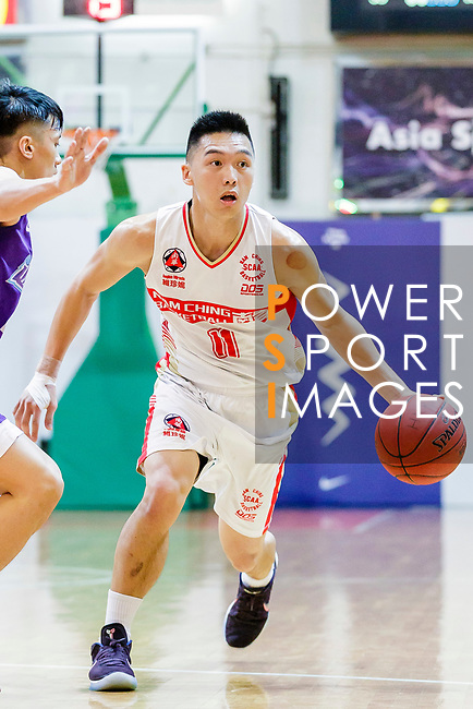 Soo Yan Lok #11 of Nam Ching Basketball Team handles the ball against the HKPA during the Hong Kong Basketball League game between Nam Ching and  HKPA at Southorn Stadium on June 12, 2018 in Hong Kong. Photo by Yu Chun Christopher Wong / Power Sport Images