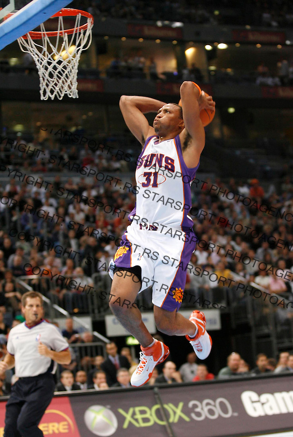 Phoenix Suns' Shawn Marion, scores, during a NBA Live Tour basketball match between Phoenix Suns and Maccabi Elite Tel Aviv at the KoelnArena in Cologne, Germany, Wednesday, Oct. 11, 2006. (Srdjan Stevanovic) &amp;#xA;<br />