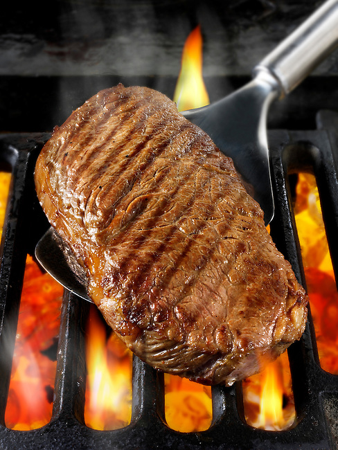 Sirloin beef steaks being cooked on a bbq. Meat food photos, pictures & images.