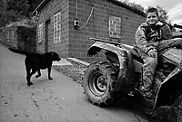 "War, WV, October 25 2008.William, 11, with his dog Bogger, on his ""fourwheeler"", spends most afternoons roaming the surrounding hill trails.""West Virginia Southernmost city"", War is a small coal miners' town, hit hard by the economic crisis; many of its inhabitants will vote for Obama as McCain is perceived to be the man from the oil companies, trying to destroy the coal mining industry."