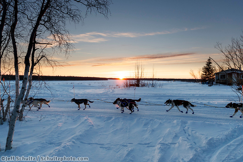 Wade Marrs runs down the trail at sunset as he leaves the Huslia checkpoint during the 2017 Iditarod on Friday evening March 10, 2017.<br /> <br /> <br /> Photo by Jeff Schultz/SchultzPhoto.com  (C) 2017  ALL RIGHTS RESERVED