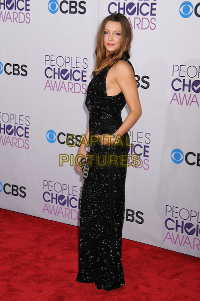 Katie Cassidy.People's Choice Awards 2013 - Arrivals held at Nokia Theatre L.A. Live, Los Angeles, California, USA..January 9th, 2013.full length black sparkly jumpsuit hand in pocket clutch bag side .CAP/ADM/BP.©Byron Purvis/AdMedia/Capital Pictures.