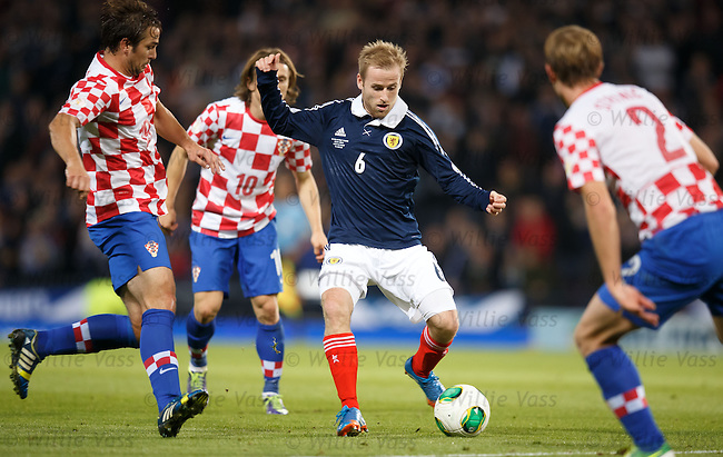 Barry Bannan tiptoes his way through the Croats