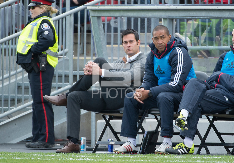 Toronto, Ontario - May 17, 2014: New York Red Bulls head coach Mike Petke watches the action during a game between the New York Red Bulls and Toronto FC at BMO Field. Toronto FC won 2-0.