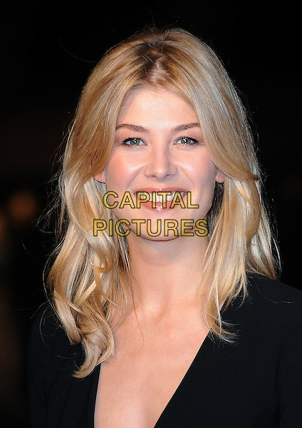 "ROSAMUND PIKE .Attending The European Premiere of ""127 Hours"" during the closing gala of the 54th BFI London Film Festival, Odeon Leicester Square, London..28th October 2010.LFF portrait headshot smiling black .CAP/BEL.©Tom Belcher/Capital Pictures."