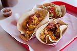 A chalupa with guacamole, a potato, egg and cheese taco and a bacon, egg and cheese taco with homemade salsa at Tamale House in Austin, Texas on Saturday, February 27, 2010...Ben Sklar for the New York Times