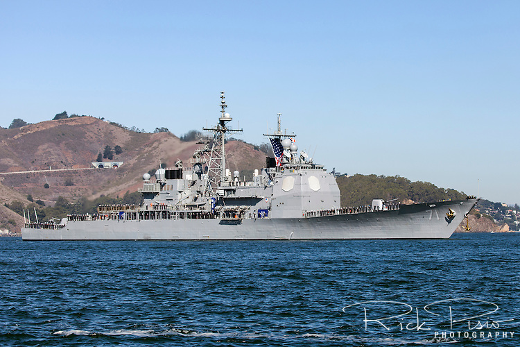 With the crew lining the rails the Arleigh Burke-class guided-missile destroyer USS Ross (DDG-71) enters San Francisco Bay.