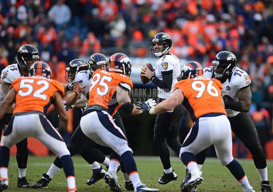Jan 12, 2013; Denver, CO, USA; Baltimore Ravens quarterback Joe Flacco (5) against the Denver Broncos during the AFC divisional round playoff game at Sports Authority Field.  Mandatory Credit: Mark J. Rebilas-