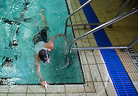 28 SEP 2014 - STOWMARKET, GBR - A competitor touches the wall at the end of the 300m swim before leaving the pool during the 2014 West Suffolk Triathlon in Stowmarket in Suffolk, Great Britain (PHOTO COPYRIGHT © 2014 NIGEL FARROW, ALL RIGHTS RESERVED)