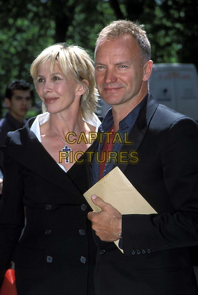 TRUDI STYLER & STING..Ivor Novello Awards ..Ref: 11708..crucifix, cross, half length, half-length, couple..www.capitalpictures.com..sales@capitalpictures.com..©Capital Pictures