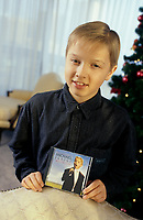 """Montreal (Qc) CANADA - File Photo - circa 1999<br /> <br /> Michael Junior hold his cd Dreamland.<br /> <br /> Michael Junior (Verschuere) was born on April 21, 1986 in Bruges St. Lucas, Belgium and grew up in Geidelberg straat. He made his singing debut in March of 1998 with Helmut Lotti at the Casino of Oostende in Belgium. Michael is becoming world famous after producing three incredible albums """"Dreamland"""", """"Musica e la vita"""", """"You Raise Me Up"""" and his most recent album, """"Life in English""""."""