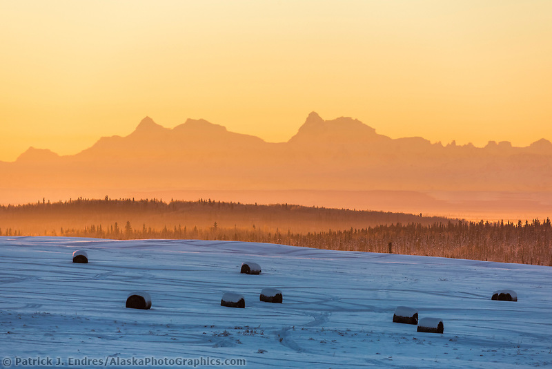 Minus 25 degree temperatures cause atmospheric abberations on a January sunrise over the Alaska Range mountains as seen from the city of Fairbanks, Alaska.