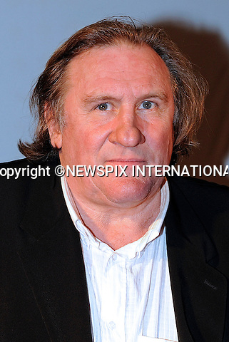 """GERARD DEPARDIEU PROTESTS NEW FRENCH TAX AND MOVES TO BELGIUM.Actor Gérard Depardieu,64, star of the """"Green Card"""" has purchased a substantial property valued at ?3 million that belonged to the Mulliez family..The property constructed by the architect Rock Small, who is well known in the region of Turn, contains an indoor swimming pool and Jacuzzi..The property is situated in Nechin, 300 metres from the French-Belgian border..France has introduced a new massive tax hike on the rich of 75 per cent on all earnings over ?1 million..The Mulliez family own the Auchan chain of stores in Europe_28/12/2012.Mandatory Photo Credit: ©Bernaux/News Pictures/NEWSPIX INTERNATIONAL.Picture Shows : Gerard Depardieu at Virgin store, Paris, France..**ALL FEES PAYABLE TO: """"NEWSPIX INTERNATIONAL""""**..PHOTO CREDIT MANDATORY!!: NEWSPIX INTERNATIONAL..IMMEDIATE CONFIRMATION OF USAGE REQUIRED:.Newspix International, 31 Chinnery Hill, Bishop's Stortford, ENGLAND CM23 3PS.Tel:+441279 324672  ; Fax: +441279656877.Mobile:  0777568 1153.e-mail: info@newspixinternational.co.uk"""