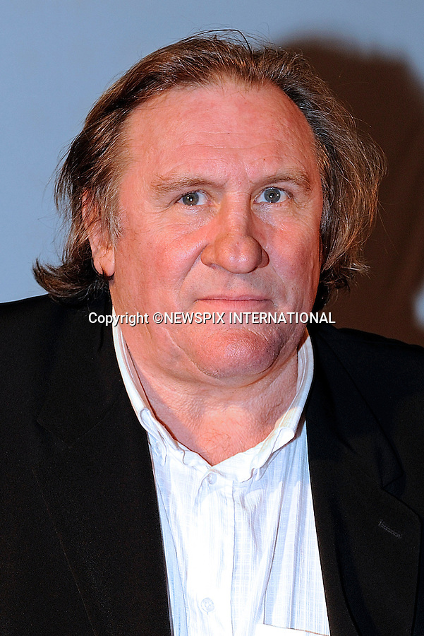 "GERARD DEPARDIEU PROTESTS NEW FRENCH TAX AND MOVES TO BELGIUM.Actor Gérard Depardieu,64, star of the ""Green Card"" has purchased a substantial property valued at ?3 million that belonged to the Mulliez family..The property constructed by the architect Rock Small, who is well known in the region of Turn, contains an indoor swimming pool and Jacuzzi..The property is situated in Nechin, 300 metres from the French-Belgian border..France has introduced a new massive tax hike on the rich of 75 per cent on all earnings over ?1 million..The Mulliez family own the Auchan chain of stores in Europe_28/12/2012.Mandatory Photo Credit: ©Bernaux/News Pictures/NEWSPIX INTERNATIONAL.Picture Shows : Gerard Depardieu at Virgin store, Paris, France..**ALL FEES PAYABLE TO: ""NEWSPIX INTERNATIONAL""**..PHOTO CREDIT MANDATORY!!: NEWSPIX INTERNATIONAL..IMMEDIATE CONFIRMATION OF USAGE REQUIRED:.Newspix International, 31 Chinnery Hill, Bishop's Stortford, ENGLAND CM23 3PS.Tel:+441279 324672  ; Fax: +441279656877.Mobile:  0777568 1153.e-mail: info@newspixinternational.co.uk"