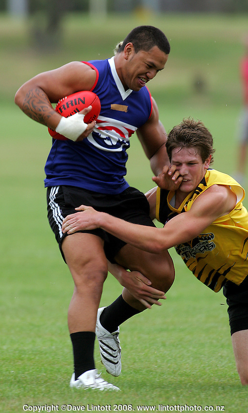 Hika Elliot fends off a Tigers tackler during the Preseason Cross-code Rugby Union v Australian Rules friendly between the Hurricanes and Wellington Tigers at  Elsdon Park, Porirua, New Zealand on Tuesday, 15 January 2008. Photo: Dave Lintott / lintottphoto.co.nz