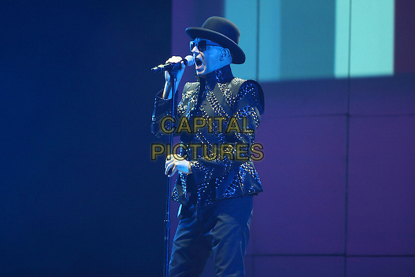 Pet Shop Boys - Neil Tennant.Concert in Moscow, Russia..June 11th, 2009.on stage in concert live gig performance performing music half length black leather jacket hat sunglasses shades singing .CAP/PER/SB.© SB/Persona/CapitalPictures