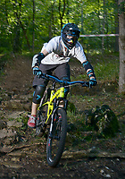 NWA Democrat-Gazette/BEN GOFF @NWABENGOFF<br /> Riders take practice runs on the downhill and super-D courses on Friday July 15, 2016 at the 18th annual Fat Tire Festival at Lake Leatherwood City Park in Eureka Springs. Short track races were held Friday evening, the downhill and super-d races will begin Saturday morning, and cross country races will take place on Sunday.