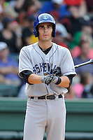Shortstop Alec Mehrten (7) of the Asheville Tourists bats in a game against the Greenville Drive on Sunday, July 20, 2014, at Fluor Field at the West End in Greenville, South Carolina. Asheville won game two of a doubleheader, 3-2. (Tom Priddy/Four Seam Images)