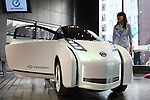 Apr. 19, 2010 - Tokyo, Japan - A Nissan Land Glide is displayed at the company's showroom in Tokyo, in the Ginza district of Tokyo, Japan, on April 19, 2010. The company's electric concept car is a one-passenger car, inspired by motorcycles, that is no more than 44 inches wide.