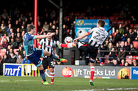 A Dayle Southwell of Wycombe Wanderers shot at goal is blocked by Danny Collins of Grimsby Town during the Sky Bet League 2 match between Grimsby Town and Wycombe Wanderers at Blundell Park, Cleethorpes, England on 4 March 2017. Photo by Andy Rowland / PRiME Media Images.