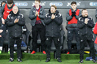 (L-R) Alan Curtis, assistant coach for Swansea, Bjorn Hamberg, assistant coach for Swansea and Billy Reid, assistant manager for Swansea applaud in tribute to Emiliano Sala during the FA Cup Fourth Round match between Swansea City and Gillingham at the Liberty Stadium, Swansea, Wales, UK. Saturday 26 January 2019