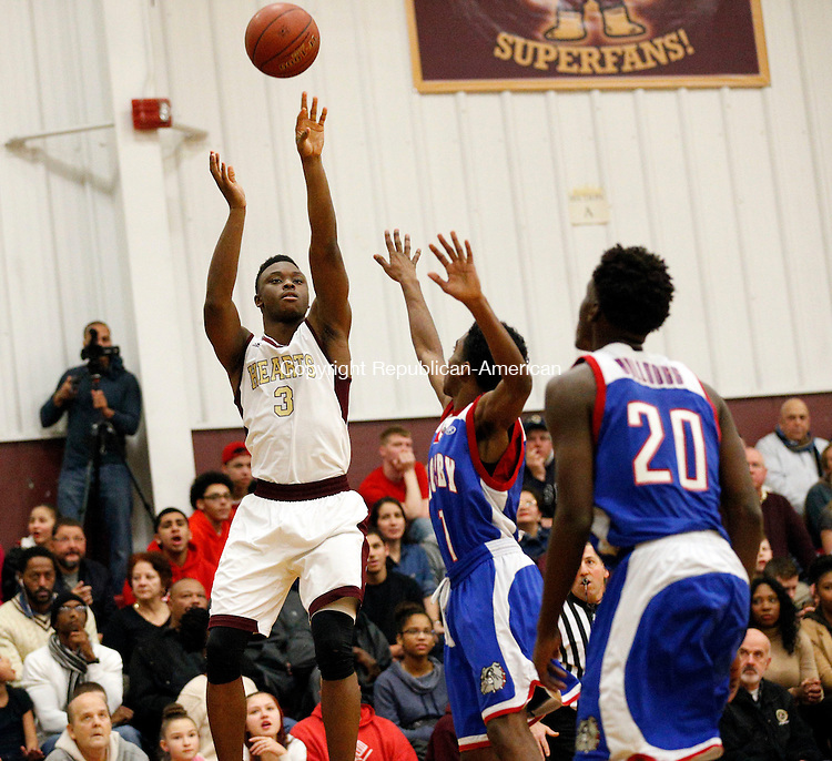 Waterbury, CT- 15 January 2016-011516CM06-  Sacred Heart's Mustapha Heron takes a jump shot against Crosby's Roary Jadusingh during their NVL matchup in Waterbury on Friday.  Sacred Heart would go onto win, 96-61.  Christopher Massa Republican-American